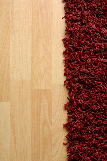 Laminate flooring laminated flooring products for Rugs for laminate floors